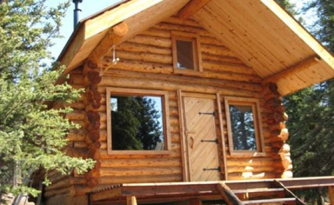 Folks Living The Simple Life In Tiny Cabin In Alaska