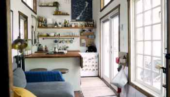 Colorful Ravenlore Tiny House by Tiny Green Cabins on home designers, knitting designers, building designers, tiny houses on wheels,