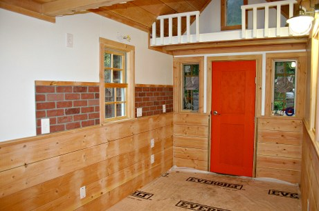 Great room in progress, including faux brick backsplash (to be sealed white).