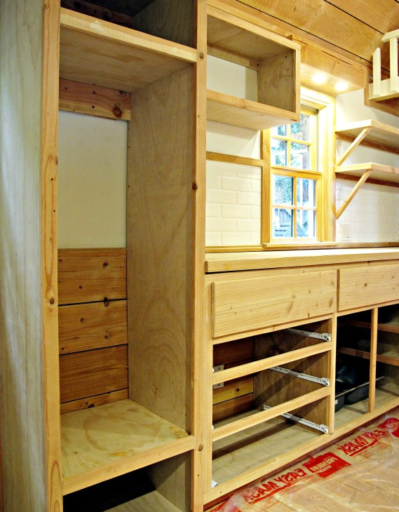 Closet space with upper and lower cubicles, all to be covered with doors.