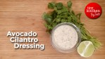 Avocado Cilantro Dressing on a bowl with lime