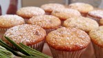 Close up of Orange Cranberry Muffins with powered sugar, rosemary