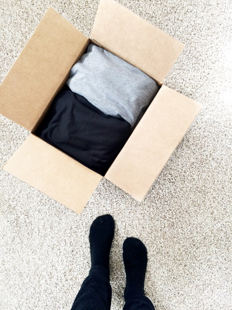 Looking down onto a box of clothes