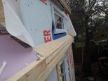 The small section of roof that runs under the dormers had to be built up as well so that the metal roof have an even surface to be installed onto.