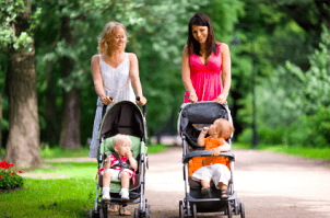 Image of a Mom carrying her baby in a stroller.