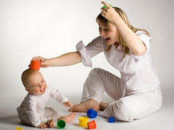 Image of Mom playing with her child