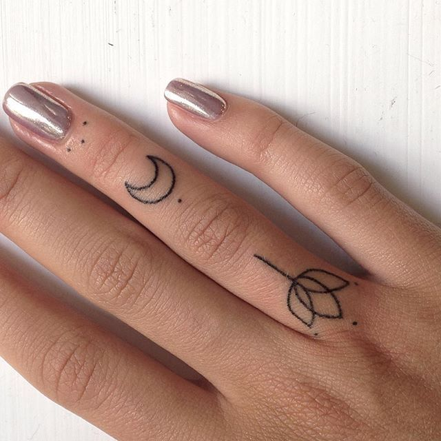 small moon tattoo on finger