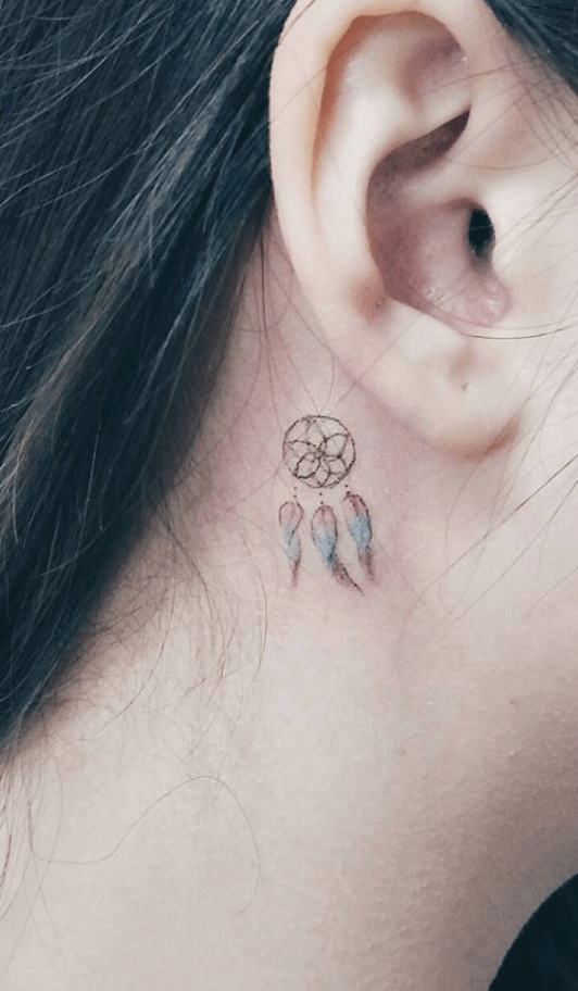 behind the ear dream catcher colored tattoo
