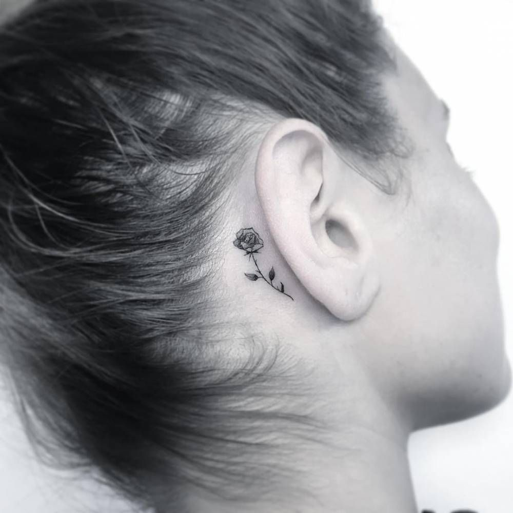 behind the ear small rose tattoo