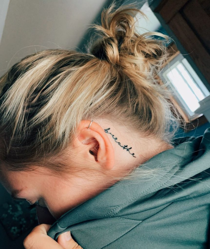 behind the ear words tattoo
