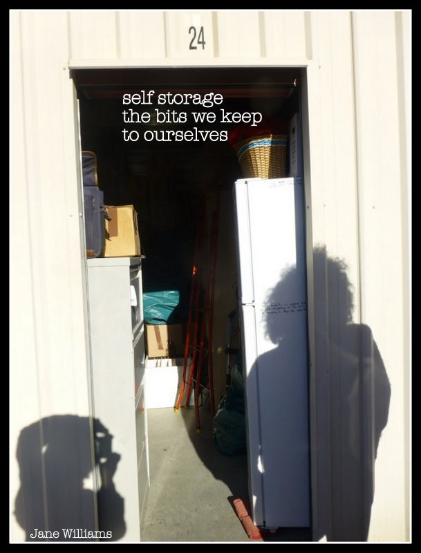 photo of a storage shed with shadows of people on it, and the text of the haiga