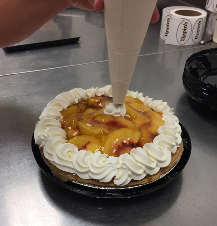 Whipped cream to top off Tippin's Peach Cooler Pie