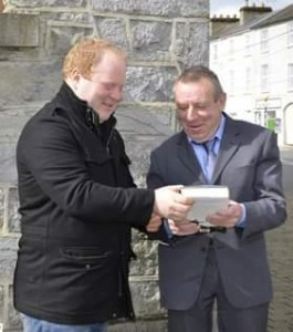 Tim Maher presenting John Connors with a token of appreciation