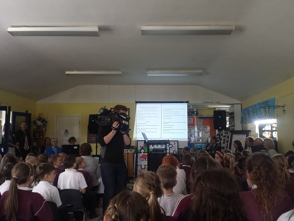 Pupils of Scoil Naomh Cualán Borrisoleigh singing their new anti litter song while being filmed by Irish TV
