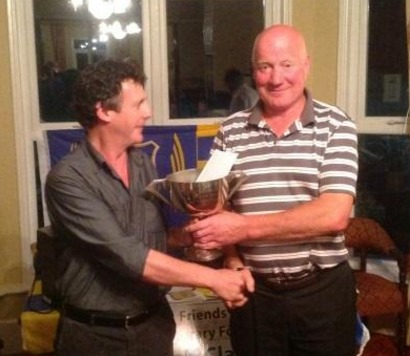 Michael Power, Chairman of Friends of Tipperary Football presenting the winner's prize to Gerry Stapleton Loughmore at the 'Friends' Golf Classic in Thurles Golf Club.