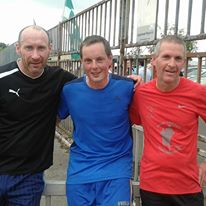 Track-Attackers Tom Shanahan, Michael Murray and John F Kennedy