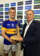 Former Dublin legend Keith Barr representing sponsors presented JohnMcGrath with his trophy after the final.