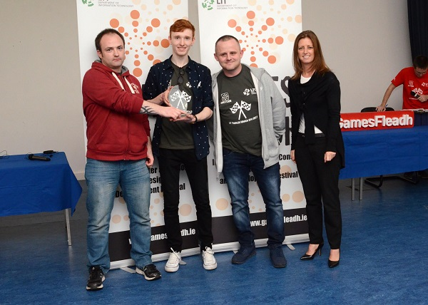 "Third Year LIT Game Development students win Best Windows Game with their game ""Antibody"" at Games Fleadh 2017 which took place in the LIT Thurles Campus on Wed March 8th They are presented with their trophy by Janice O'Connell Head of the IT Department at LIT. Photographed Left to Right: Joe O'Regan (Thurles, Tipperary), Sean Horgan (Killarney, Kerry), Brian Ryan (Cashel, Tipperary) and Janice O'Connell LIT."