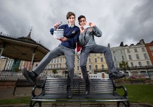 """Mattia Nardon, Cobh Community College and Rithik Makker, Coláiste Muire, Cobh celebrate winning the overall prize in the Trend Micro 'What's Your Story' video competition for their video entitled """"Power Off"""". The video discussed the importance of balancing social media in young people's lives, which was along with social media addiction was a recurring theme in this year's competition."""