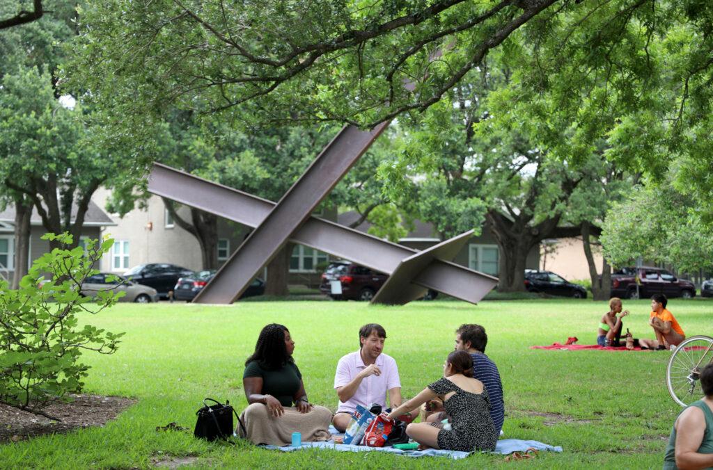 Houston locals enjoying the Menil's green spaces