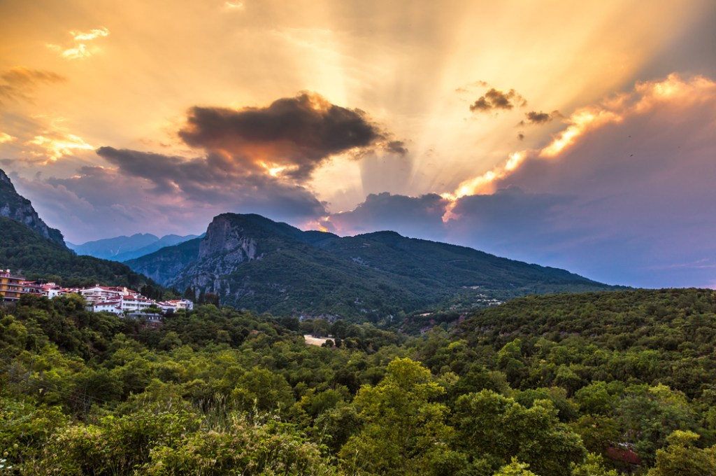A heavenly photo of the sun setting over Mount Olympus.
