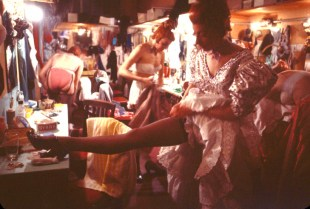 """Dancers getting ready for their """"La Goulue"""" performance in the dressing room of the Moulin Rouge nightclub."""