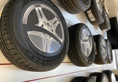 A tires showroom rack with various unmatched tires.