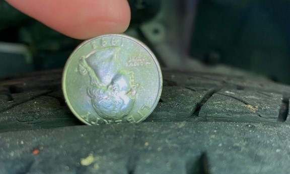 the 'quarter test' to gauge tread life of your tire.  This one is low and should be replaced soon!