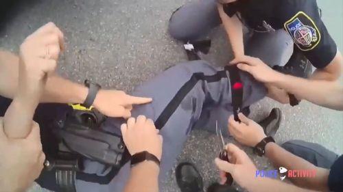 Uso del torniquete con policía herida en la pierta. Dundalk, Maryland (EE.UU.). 07JUN17