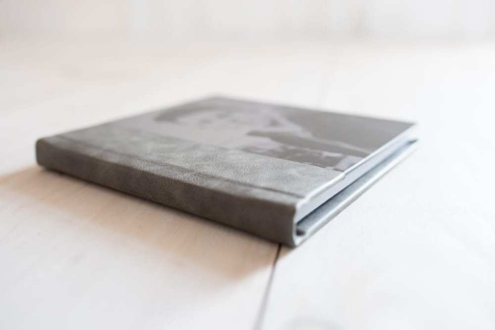 Custom Designed Leather & Linen Albums for displaying your newborn babies, high school seniors, Families, or wedding photos