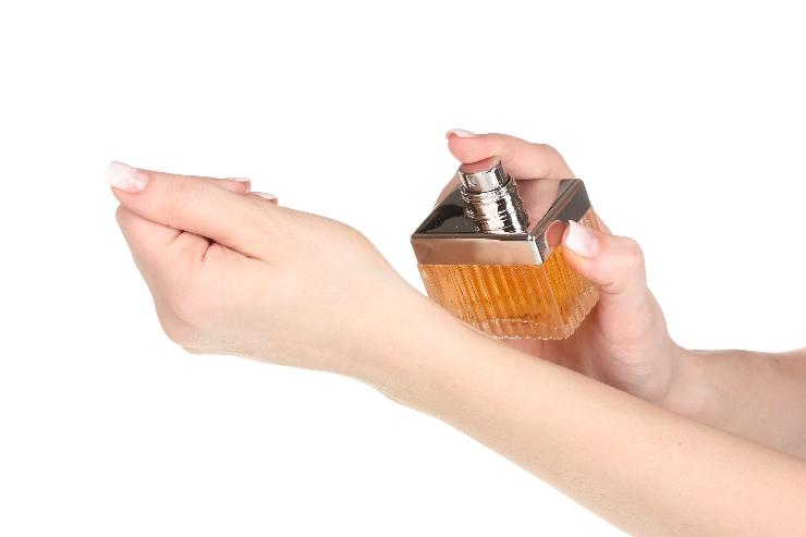 Perfume spray on wrist