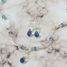 A Blizzard of Bling Set Ice Blue Necklace and earrings.