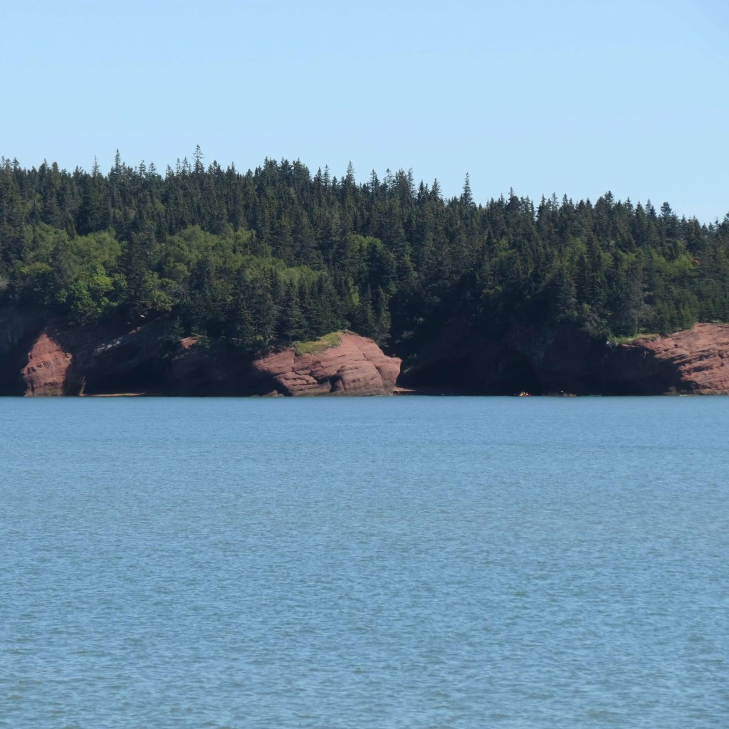 A closer look at The Caves of Saint Martins from a distance.