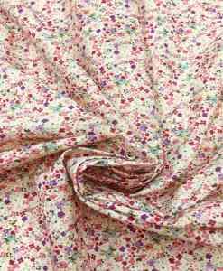 Tissu coton fleuris rose du dessert