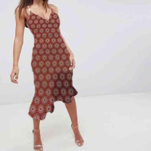 Tissu coton motif soleil brique