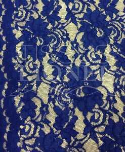 Tissu dentelle couture festonnée royal