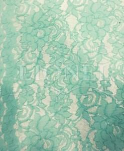 Tissu dentelle couture festonnée vert pâle