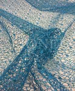 Tissu filet turquoise pailleté argent