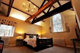 Farmhouse Cottage Master Bedroom (Door View)
