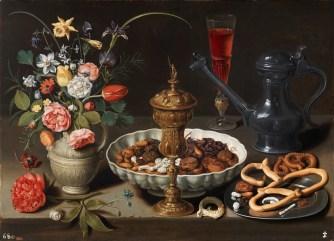 bodegon-con-flores-copa-de-plata-dorada-frutos-secos-dulces-panecillos-vino-y-jarra-1611