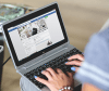 hands-woman-laptop-facebook
