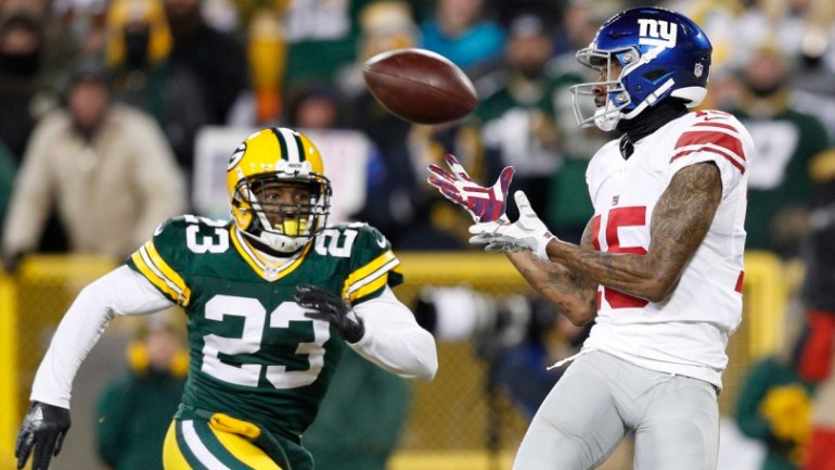 Jan 8, 2017; Green Bay, WI, USA; New York Giants wide receiver Tavarres King (15) catches a touchdown pass against Green Bay Packers cornerback Damarious Randall (23) during the third quarter in the NFC Wild Card playoff football game at Lambeau Field. Mandatory Credit: Jeff Hanisch-USA TODAY Sports