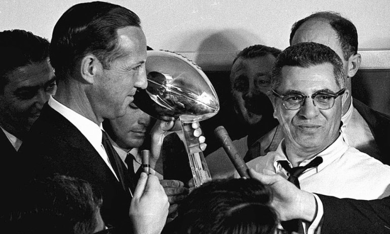 FILE - In this Jan. 15, 1967, file photo, football commissioner Pete Rozelle, left, presents the trophy to Green Bay Packers coach Vince Lombardi after they beat the Kansas City Chiefs 35-10 in Super Bowl I in Los Angeles. (AP Photo, File) ORG XMIT: NY168