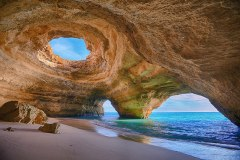 Cave Beach in Algarve, The Algarve coast consists of limestone, which is easily eroded and can form stunning sea caves like this one. Portugal. Image credits: Bruno Carlos