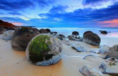 The Moeraki Boulders (Dragon Eggs) In Koekohe Beach, New Zealand. The boulders on this New Zealand beach are concretions – balls of sedimentary rock harder than the sedimentary earth that formed around them, which has long since washed away. These boulders get uncovered and smoothed by pounding waves. Image credits: Farkul J
