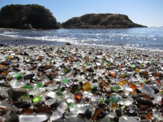 Unique Glass Beach in California. The glass beach near Fort Bragg in California formed after the trash dumped there for years by local residents was pounded into sand by the surf. The dumping was eventually prohibited, but the glass sand remains.