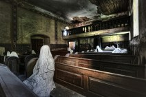 """Church of the 9 Ghosts"" - An abandoned church inhabited by nine 'ghosts' sitting in the pews dressed in wrinkly white cloths. Spooky.Photo By Niki Feijen"