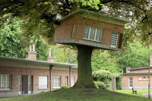 Senior Center Turned Treehouse (Ghent, Belgium) This sculptural tree house in Belgium was made for the art festival TRACK: A Contemporary City Conversion, and is a miniature version of the houses behind it. (Designed by: Benjamin Verdonck)