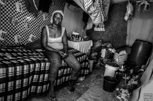 Patricia, 32, lives in the tent on her own. She had to send her three children to Gonaïves to live her parents after the second evacuation. She has stays in Camp Mozayik to work and send money for the kids. Photo by Bahare Khodabandeh, Jan 11 2015, Haiti.