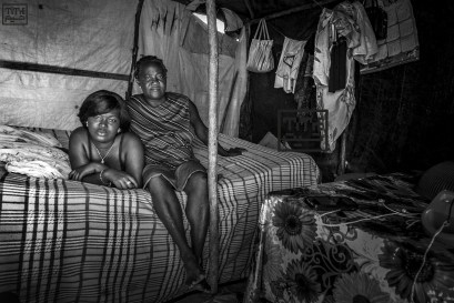Adrienne, 55, lives with her young daughter. She normally sells what she can get in the market (very common among Haitian women) but lately she has been suffering from pain in her feet and has not been able to work. Photo by Bahare Khodabandeh, Jan 11 2015, Haiti.